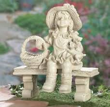 the oversized boy on bench garden statue adds a charming