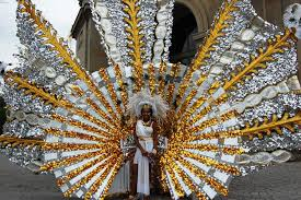 carnival costumes models in traditional feathered and sequined carnival costumes