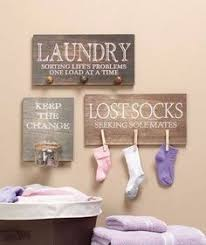 Laundry Room Pictures To Hang - use stacked curtain rods in laundry room to hang dry clothes or to
