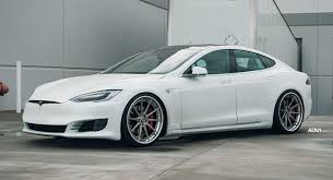 white tesla model s stuns on adv 1 wheels
