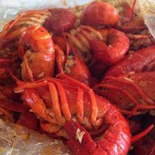 head on shrimp crawfish corn sausage drenched in sauce and