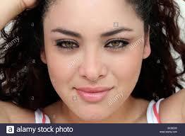 hispanic hair pics close up big eyes green curly hair smiling girl woman stock