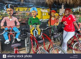 johannesburg south africa african soweto lebo s backpackers hostel johannesburg south africa african soweto lebo s backpackers hostel bicycle rental shop black woman guide employee job wall mural art painting