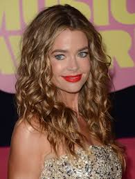 long layered haircuts over 40 denise richards long wavy style popular haircuts