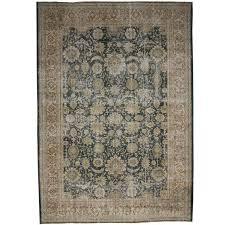 distressed vintage turkish sivas area rug with industrial