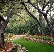 How To Landscape A Sloped Backyard - clever ideas for a sloping backyard renovate u0026 real estate