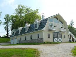 exterior design dark gambrel roof with white trim board and