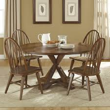 five piece round top pedestal table and spindle back chair set by