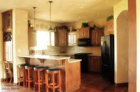 Decorating Ideas Above Kitchen Cabinets by Space Above Kitchen Cabinets Dark Counter Closet Design Ideas