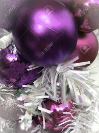 purple and pink ornaments christmas time decorations stock photo