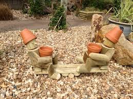 flowerpot man flowerpot men seesaw swing ladder chair