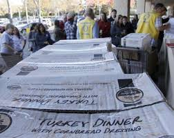 volunteers deliver thanksgiving meals to families
