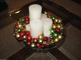 White Christmas Centerpieces - christmas centerpieces with big white candle and colorful mini