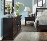 interior design black leather couch beige carpet furniture