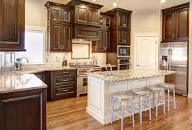 brown kitchen cabinets to white perimeter cabinets with white island cabinets and light