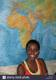 Continent World Map by Young Black Woman Sitting In Front Of African Continent On