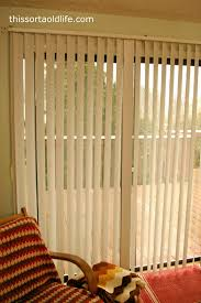 hanging curtains over sliding glass door vertical blinds for sliding glass doors great idea for covering