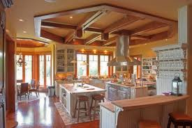 kitchen island with range range hood over white wooden