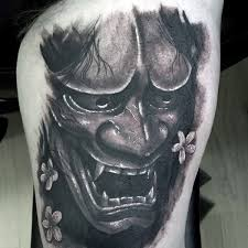 hannya mask tattoo black and grey hannya mask tattoo a face of hannya mask design with flowers