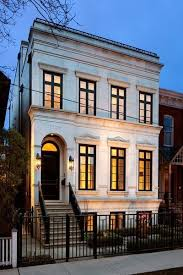 neoclassical house neoclassical row house with limestone exterior accented with black