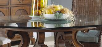 Circle Glass Dining Table With Brown Wooden Carving Bases Of - Glass dining room table bases