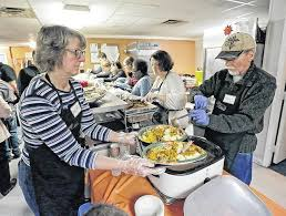 volunteers serve thanksgiving dinner to about 70 at keystone