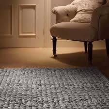 floor beige slipcovers design with grey rug and wooden flooring