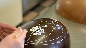Decorating Easter Eggs Video by Family Members Take Decorative Easter Eggs From The Table Stock