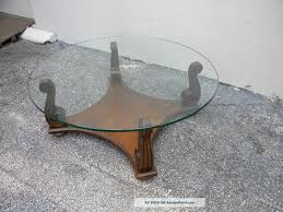 incredible round glass top coffee table with wood base with