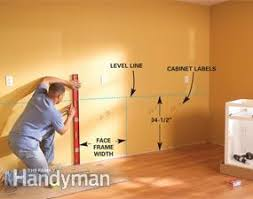 how to fix kitchen base cabinets to wall how to install kitchen cabinets diy family handyman