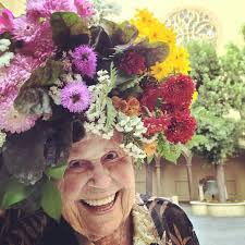 flower farmer grows smiles by putting flowers on strangers heads