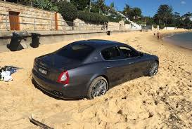 yellow maserati ghibli maserati quattroporte gets bogged on sydney beach performancedrive