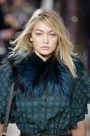 new york hair show 2015 michael kors fall 2015 models wear hair in super low ponytails