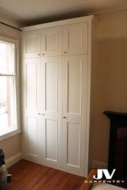 traditional fitted wardrobe sbeaded shaker doors and cornice over
