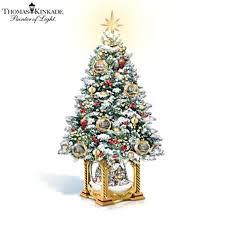 kinkade illuminated tree with melody kinkade snow