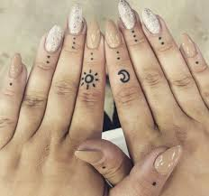 small sun and moon finger ink youqueen girly tattoos