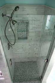white carrara marble tile with a frameless glass enclosure
