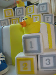 yellow and gray baby shower cake with fondant covered blocks