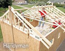 how to build a floor for a house how to build a garage framing a garage family handyman
