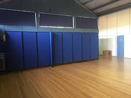 mobile room dividers hiding unsightly storage in a gym using portable partitions