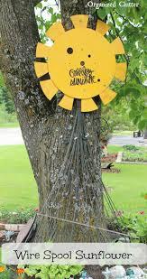 organized clutter wire spool end garden junk sunflower