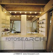 Lighting For Beamed Ceilings Stock Photo Of Lighting And Mirror Above Basins In Fitted