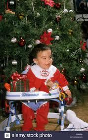 hispanic baby boy christmas tree costume smile happy laugh toy