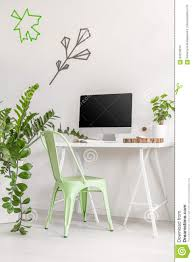 minimalist office interior with mint chair and plants stock photo
