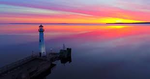 Light Of Dawn Lighthouse Blinks In Scenic Harbor Time Lapse As The Light Of