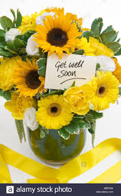 get well soon cards a vase with flowers and a get well soon card stock photo royalty