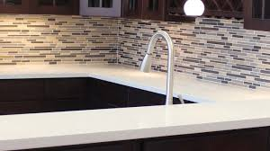 dark kitchen cabinets light countertops stainless steel