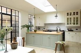 green and white kitchen cabinets green white kitchen with wooden benchtops and rustic details in