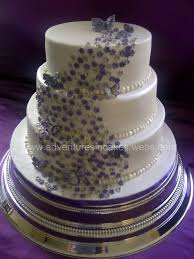 silver wedding cakes purple and silver wedding cake with flowers butterflies