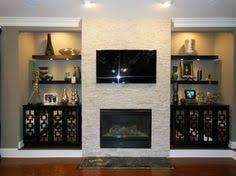 Mounting Tv Over Brick Fireplace by System For Hiding Cords To A Wall Mounted Tv Over Mantel Ideas